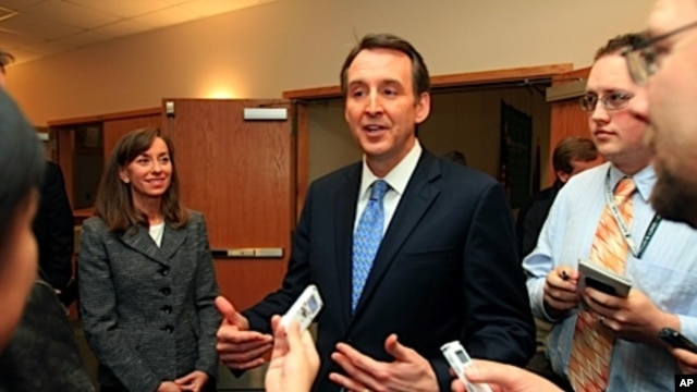With his wife Mary at his side, likely Republican presidential hopeful, former Minnesota Gov. Tim Pawlenty speaks with reporters in Lebanon, N.H, March 11, 2011