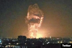 A social media image purportedly shows flames and smoke from an explosion rising into the night sky in Tianjin, China.
