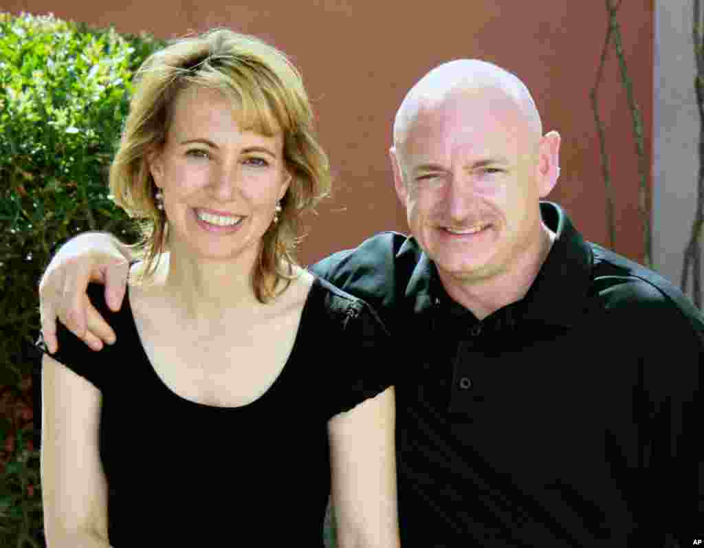 This file photo provided by the office of Rep. Gabrielle Giffords, shows her, left, with her husband, NASA astronaut Mark Kelly. Aides to Giffords have been preparing for her to travel to Florida to watch her husband's space shuttle launch planned for the