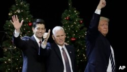 President-elect Donald Trump, Vice-President-elect Mike Pence and House Speaker Paul Ryan wave at a rally Tuesday, Dec. 13, 2016, in West Allis, Wisconsin. (AP Photo/Morry Gash)
