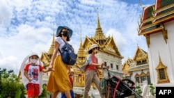 People visit the Grand Palace in Bangkok on June 7, 2020, as it reopened for visitors following restrictions to halt the spread of the COVID-19.