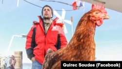 Guirec Soudee and his hen Monique are sailing around the world together