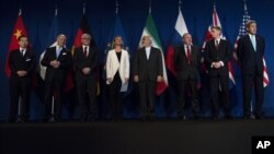 From left, Head of Mission of People's Republic of China to the European Union Hailong Wu, French Foreign Minister Laurent Fabius, German Foreign Minister Frank Walter Steinmeier, European Union High Representative for Foreign Affairs and Security Policy Federica Mogherini, Iranian Foreign Minister Javad Zarifat, an unidentified Russian official, British Foreign Secretary Philip Hammond and US Secretary of State John Kerry arrive, at the Swiss Federal Institute of Technology, or Ecole Polytechnique Federale De Lausanne, in Lausanne, Switzerland, Thursday, April 2, 2015, after Iran nuclear program talks finished with extended sessions. The United States, Iran and five other world powers on Thursday announced an understanding outlining limits on Iran's nuclear program so it cannot lead to atomic weapons, directing negotiators toward achieving a comprehensive agreement within three months. (AP Photo/Brendan Smialowski, Pool)
