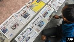 FILE - A vendor arranges newspapers in Siliguri, India, Jan. 21, 2021.