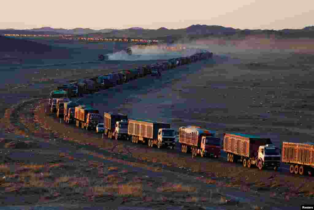 Thousands of heavy-duty trucks loaded with coal are lined up for up to 130 kilometers from the Mongolia-China border in the Gobi desert, Mongolia.