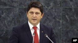 FILE - Romanian Foreign Minister Titus Corlatean speaks during the 68th session of the General Assembly at United Nations headquarters.
