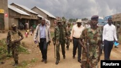 M23 rebel leaders are escorted in Bunagana, in the eastern part of the Democratic Republic of Congo, in this September 8, 2013, file photo.