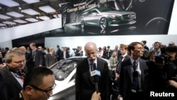 Daimler AG Chief Executive Officer Dieter Zetsche (C) speaks to the media after he unveiled the Mercedes-Benz Concept Style Coupe at Auto China 2012 in Beijing, April 23, 2012.