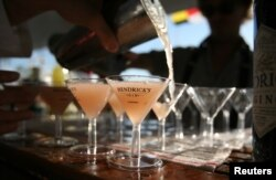 FILE - A bartender pours martinis on a yacht at the United States Sailboat Show in Annapolis, Maryland.