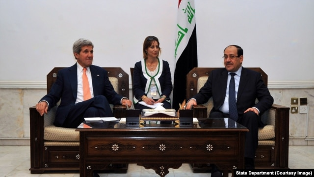 Secretary Kerry sits with Iraqi Prime Minister al-Maliki before meeting in Baghdad, June 22-27, 2014.