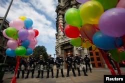 Riot police stand guard during a Pride march in Belgrade, Serbia, Sept. 28, 2014.