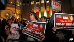 "Protesters opposed to the appearance of Republican presidential candidate Donald Trump's appearance as a guest host on this weekend's ""Saturday Night Live,"" shout anti-Trump slogans in front of NBC Studios in New York, Nov. 4, 2015"