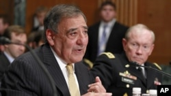 Defense Secretary Leon Panetta, left, accompanied by Joint Chiefs Chairman Gen. Martin Dempsey testifies on Capitol Hill in Washington, June 13, 2012.