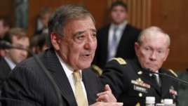 Defense Secretary Leon Panetta, left, accompanied by Joint Chiefs Chairman Gen. Martin Dempsey, testifies on Capitol Hill in Washington, Wednesday, June 13, 2012.