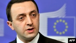 FILE - Georgia's prime minister, Irakli Garibashvili, is seen speaking during a press conference in Brussels.