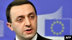 FILE - Georgia's Prime Minister Irakli Garibashvili speaks during a news conference with the European Commission president following their working session at EU headquarters in Brussels on Feb. 3, 2014.