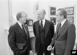 President Jimmy Carter, left, with Gerald Ford and Richard Nixon