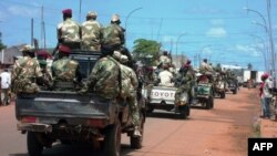 Central African troops in charge of disarmament drive through Bangui, Central African Republic, Sept. 5, 2013.