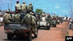 FILE - Central African troops in charge of disarmament drive a tank through Bangui, Central African Republic.