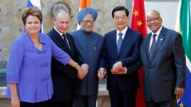 BRICS' heads of state, from left, Brazil's President Dilma Rousseff, Russia's President Vladimir Putin, India's Prime Minister Manmohan Singh, China's President Hu Jintao and South Africa's President Jacob Zuma pose for a group photo at the G-20 Summit in