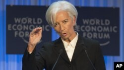 International Monetary Fund Managing Director Christine Lagarde gestures as she speaks to the assembly at the 43rd Annual Meeting of the World Economic Forum in Davos, Switzerland, Jan. 23, 2013.