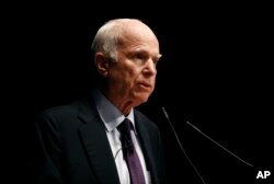 FILE - Sen. John McCain, R-Ariz., delivers remarks at the U.S. Naval Academy in Annapolis, Maryland, Oct. 30, 2017.