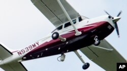 In this photo taken May 26, 2015, a small plane flies near Manassas Regional Airport in Manassas, Virginia. The plane is among a fleet of surveillance aircraft by the FBI, which are primarily used to target suspects under federal investigation.