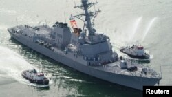 FILE - The USS Mason arrives at Port Canaveral, Florida.