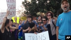 FILE - People protest outside the North Carolina Executive Mansion in Raleigh, N.C. A North Carolina proposal to forbid transgender people from using restrooms that correspond to their gender identity is part of a backlash by lawmakers across the historic South.