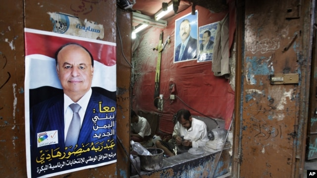 A Sana'a maker of traditional daggers displays loyalties to President Hadi (left) and to Saleh, Yemen's ousted ex-president (AP)