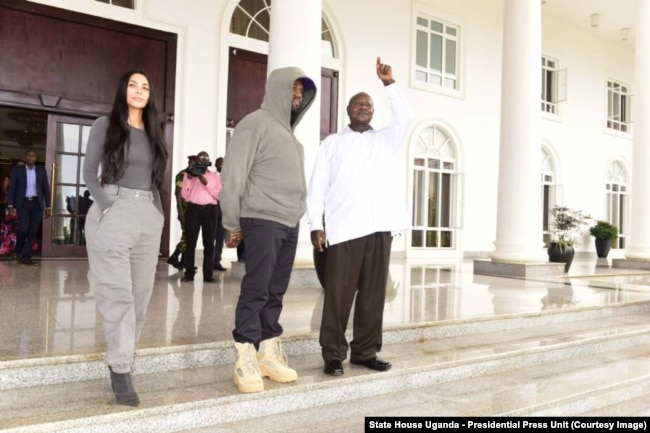 Kim Kardashian, Kanye West and Uganda President Yoweri Museveni chat outside State House Entebbe, Oct. 15, 2018.
