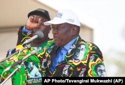 FILE - Emmerson Mnangagwa, then-vice president of Zimbabwe, greets party supporters in Gweru about 300 kilometres south west of the capital Harare, Sept, 1, 2017.