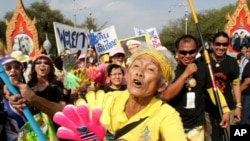 A supporter of the People's Alliance for Democracy (PAD) gestures during a rally outside the Government House in Bangkok, 25 Jan 2011