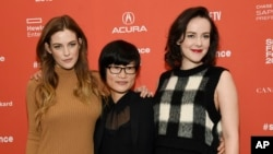"""So Yong Kim, center, director of """"Lovesong,"""" poses with cast members Riley Keough, left, and Jena Malone at the premiere of the film at the 2016 Sundance Film Festival in Park City, Utah, Jan. 25, 2016."""