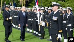 New Zealand Biden Visit: U.S. Vice President Joe Biden, center, inspects an honor guard during a ceremony at Government House in Auckland Thursday, July 21, 2016.