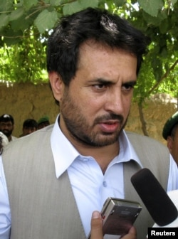 Afghanistan's Intelligence Chief Asadullah Khalid speaks to the media in the Arghandab district of Kandahar province, June 20, 2008.