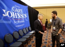 Libertarian presidential candidate Gary Johnson speaks to a delegate at the National Libertarian Party Convention, May 27, 2016, in Orlando, Florida.