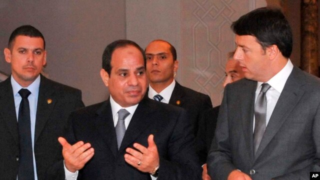 In this photo provided by Egypt's state news agency MENA, Egyptian President Abdel-Fattah el-Sissi, center, escorts Italian Prime Minister Matteo Renzi, right, to a joint press conference, in the presidential palace in Cairo, Aug. 2, 2014.