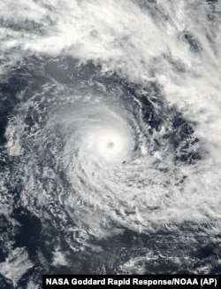 A satellite image released by NASA Goddard Rapid Response shows Cyclone Winston in the South Pacific Ocean, Feb. 19, 2016. The Pacific island nation of Fiji readied as a formidable cyclone with winds of 300 kph (186 miles) bore down.