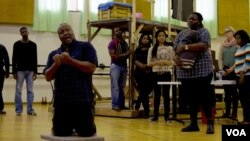 Otto Maidi, who plays Porgy in the Cape Town Opera Company's production of Porgy and Bess, sings a solo during rehearsals in June, Cape Town, South Africa. (Peter Cox/VOA)