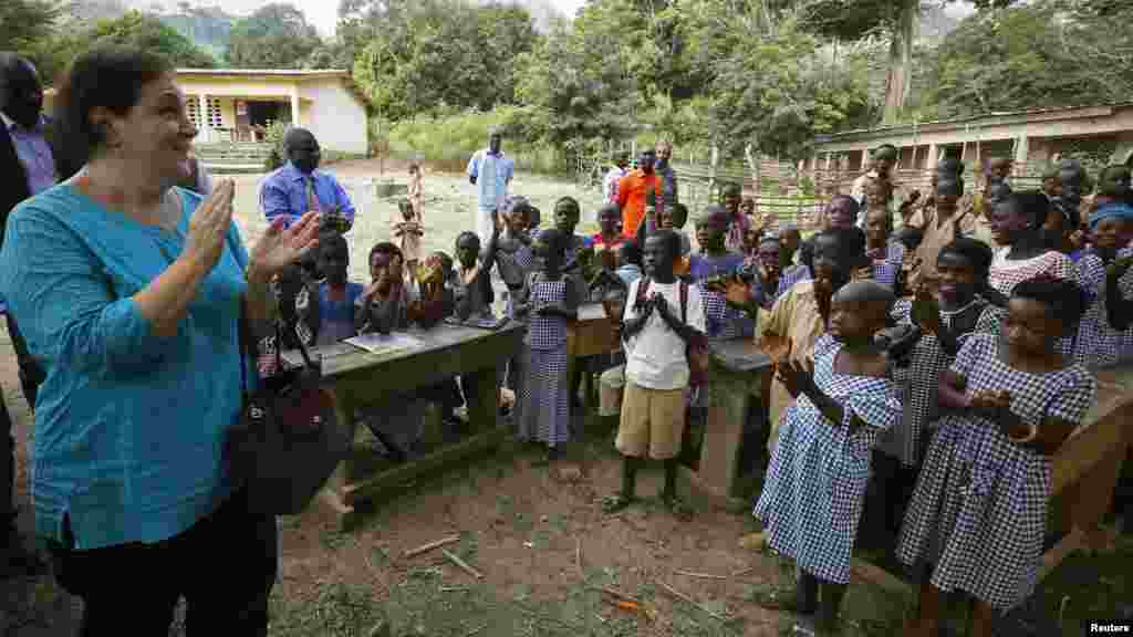 Students welcome United Nations Children's Fund (UNICEF) Ivory Coast Representative Adele Khudr as she arrives for a Ebola awareness drive in Gueupleu, Man, in western Ivory Coast, Nov. 3, 2014.