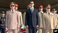 Syrian President Bashar Assad, center, General Hassan Turkmani, right, and General Ali Habib, chief of staff, left, tomb of the unknown martyr, near Damascus, Oct. 6, 2007.