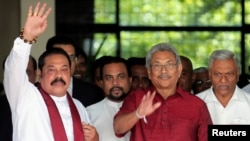 Gotabaya Rajapaksa, Sri Lanka People's Front party presidential election candidate and former wartime defence chief, with his brothers, Mahinda Rajapaksa, former president and opposition leader and Chamal Rajapaksa (R) are seen as they leave after…