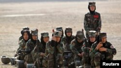Afghan National Army (ANA) female officers watch a training exercise at the Kabul Military Training Centre (KMTC) in Kabul, October 8, 2013. REUTERS/Omar Sobhani (AFGHANISTAN - Tags: MILITARY) - RTX143OO