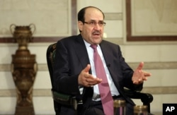 FILE - Nouri al-Maliki is seen in a Feb. 2, 2015, photo.