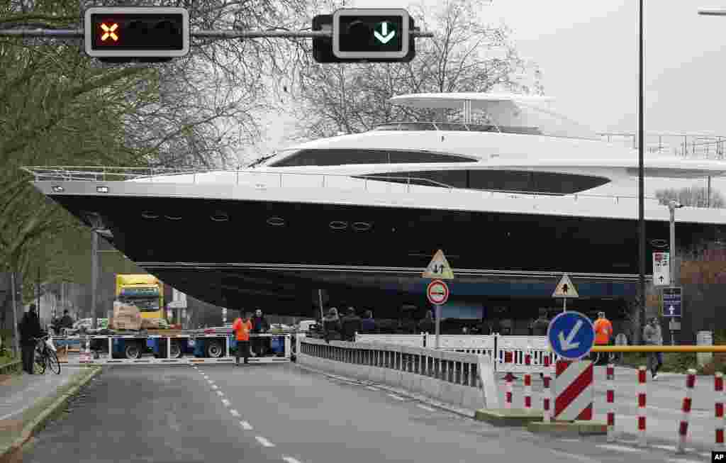 The yacht MY 98 is carried by a truck to the fairground in Düesseldorf, Germany. The boat of the British Princess shipyard with a length of 30 meters (90ft) weighs 100 tons, worth around 7 million euro ($8.3 million), and will be on display at the international boat fair in Düesseldorf from Jan. 17 until Jan. 25, 2015.
