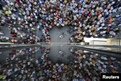 People are reflected on a building as they take part in a pro-EU demonstration in Iraklio on the island of Crete, Greece, July 2, 2015.