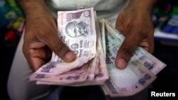Bank Sentral India secara tidak terduga memangkas suku bunga penting hingga seperempat persen point menjadi 7,75 persen (Foto: ilustrasi).
