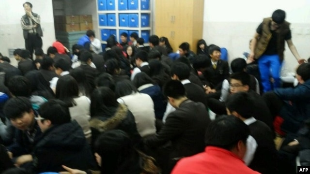 This handout picture released by Ongjin County office on March 31, 2014, shows students taking shelter at the South Korea-controlled island of Baengnyeong as North Korea started a live-fire drill. (AFP/Ongjin County Office)