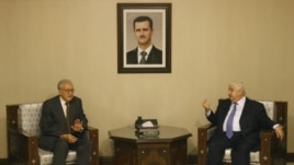 Lakhdar Brahimi, the U.N.-Arab League envoy to Syria, left, meets with Syrian Foreign Minister Walid Moallem, right, in Damascus, Syria, September 13, 2012.